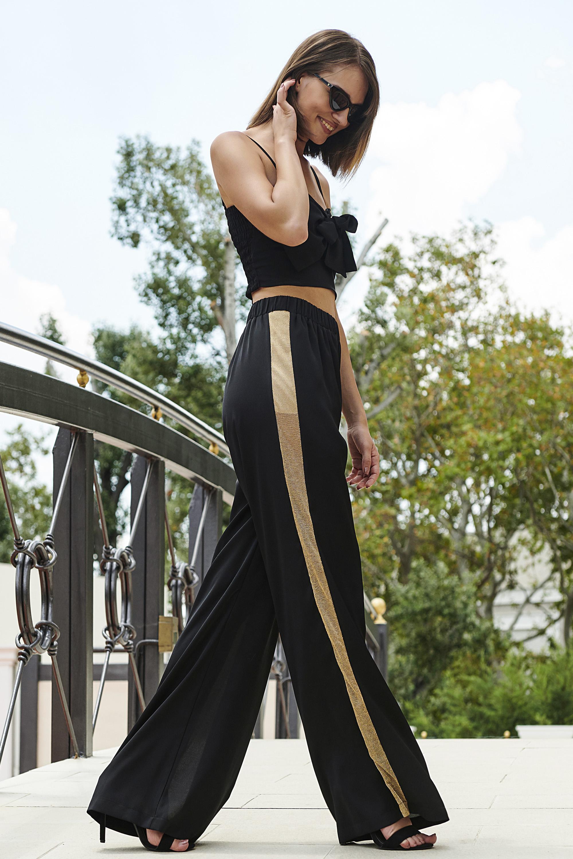 22d5a040c2c3 Uma παντελόνι μαύρο με χρυσή ρίγα – Joy
